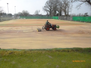 Final process with the sand being brushed into the carpet pile.