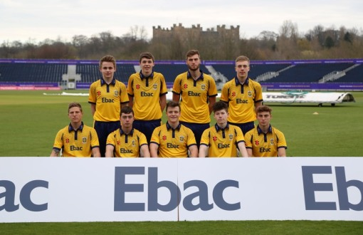Chris McBride (back left) pictured with Durham Academy ©Durham CCC