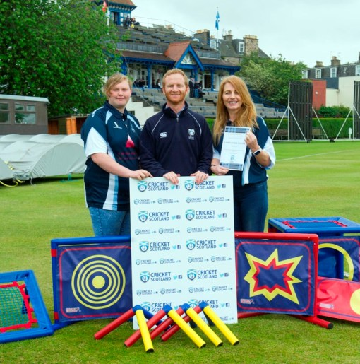 Ian Sandbrook of Cricket Scotland presents to Brogan and Amanda